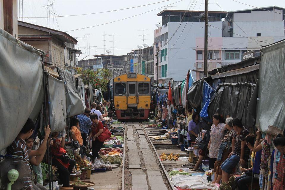 Damnoen Saduak Floating Market & Maeklong Train Market Tour